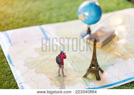 Women traveler Is planning a tour her standing on the world map.She is take a photo.Travel concept.