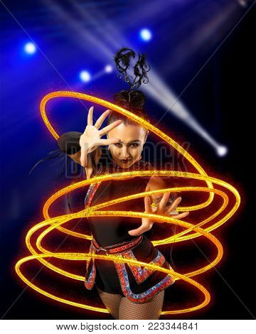 Elegance woman juggler carries out show with hoops