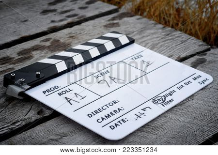 Directors clapboard on a wooden walkway on a movie set