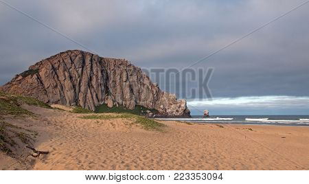 Morro Rock at sunrise at Morro Bay State Park beach on the  Central California Coast United States