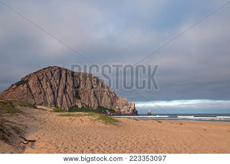 Morro Rock at sunrise at Morro Bay State Park beach on the  Central California Coast US