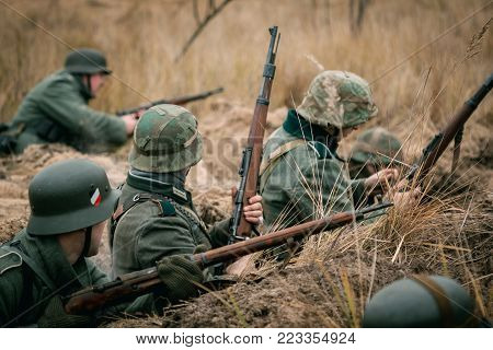 German soldiers Wehrmacht with rifles in the trench. Defense against the Soviet Army