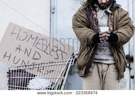 Dirty Beggar Sitting On Night-bag