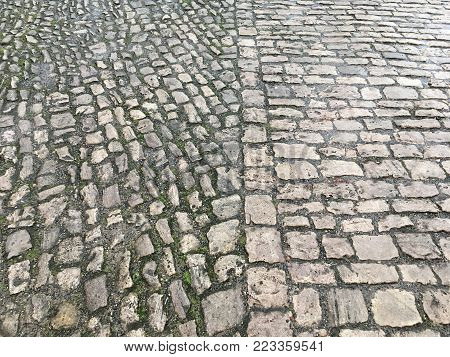 two types of paving stones lie on the ground, different centuries, the eleventh and the fifteenth century, laid close, grayscale, Germany, Bamberg