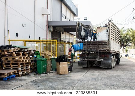 Waste Management, The garbage truck with worker