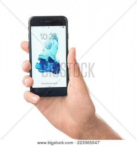 KYIV, UKRAINE - OCTOBER 17, 2017: Man holding iPhone 7 Black with lock screen on white background