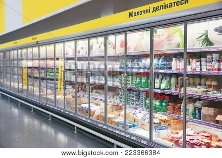 MYKOLAIV, UKRAINE - October 31, 2017: Cooling shelves with dairy products in hypermarket METRO