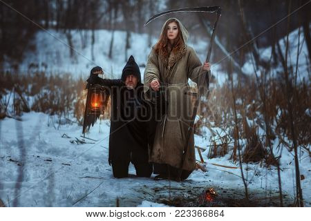 Woman with a scythe and a dreadful dwarf, they are horrifying.