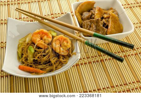 Chinese food dishes cantonese rice, noodles, beef with bamboo