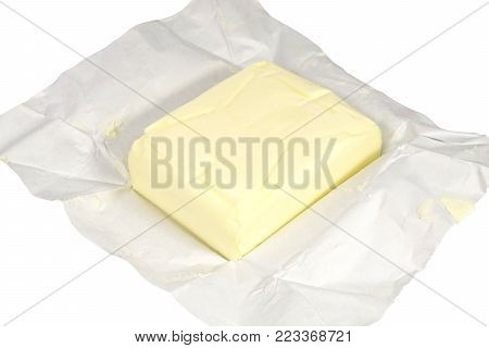 whole cube of butter on white background