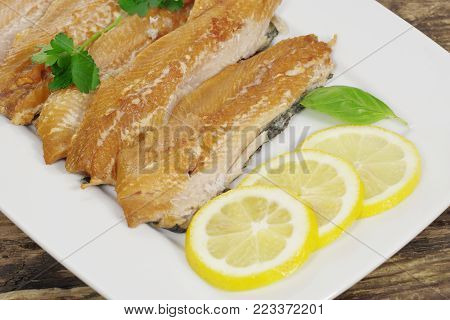 smoked herring fillets with lemon and basil