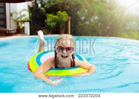 Child In Swimming Pool. Kids Swim. Water Play.