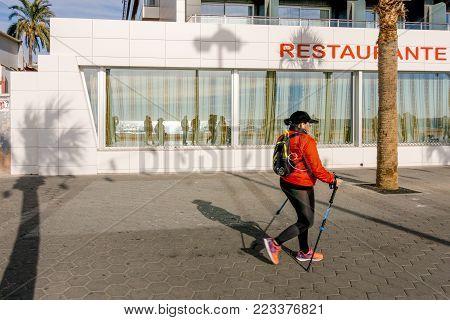 Benidorm, Spain - January 14, 2018: Active woman enjoying holiday in Benidorm, Spain