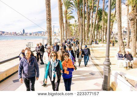 Benidorm, Spain - January 14, 2018: People walking and enjoying holiday in Benidorm, Costa Blanca, Spain