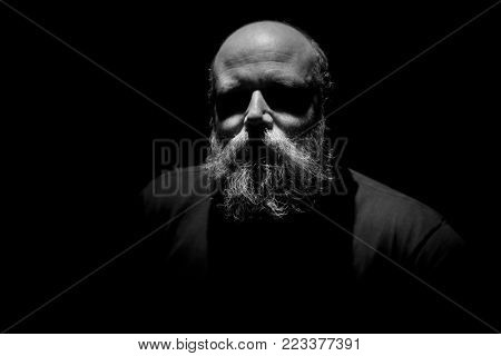 An image of a strange man with eyes in shadow