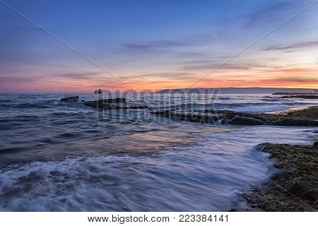 Beauty long exposure sea sunset and waves flow out