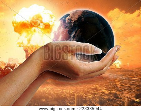 Explosion of a nuclear bomb. Saving the planet earth from nuclear weapons. Nature. Planet in the hands.