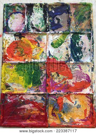 Painters pallet of multicoloured bright acrylic paint