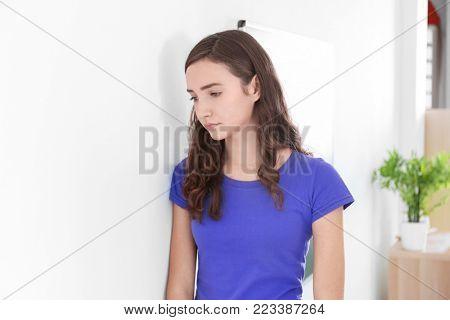 Depressed teenage girl at school