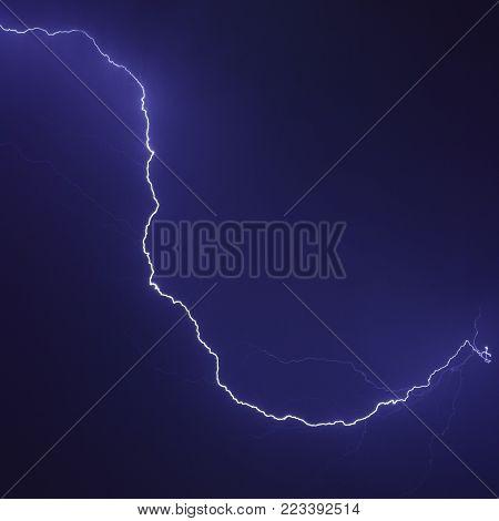 Lighting strike. Single lightning discharge in the night sky.