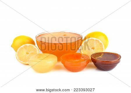Different kinds of fresh honey with lemon isilated on white background