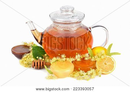 Herbal tea with linden flowers and different kinds of fresh honey on a white background