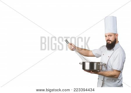 bearded cook whisking smth in a saucepan and looking to the camera isolated on a white background. Space for text