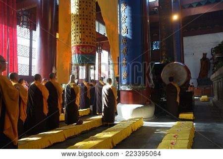 HANGZHOU, CHINA-JAN 08, 2018: Buddhist monks in Lingyin Temple in Hangzhou, China. Lingyin Temple is a Buddhist temple of the Chan sect located north-west of Hangzhou
