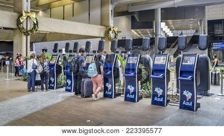 Belo Horizonte, Brazil - Dec 22, 2017: Passengers at check in terminals for Azul airliner at Horizonte's Aeroporto Internacional de Confins