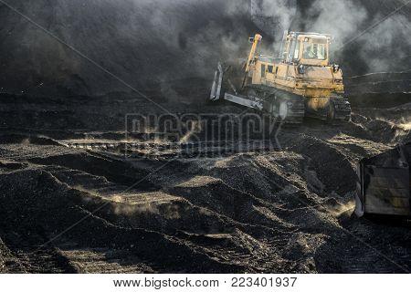 Excavator is working, dirty job, industrial, hard work
