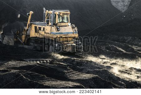 Excavator is working, dirty job, industrial, hard work