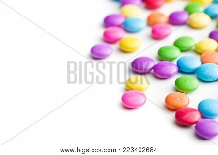 Colorful chocolate candies isolated on white background.