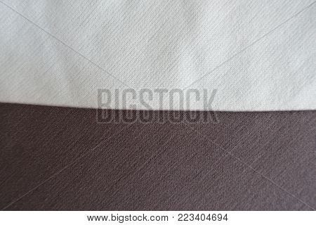 White and brown fabrics sewn together horizontally