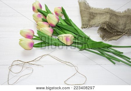 tulips with a drawstring. Pink tulip. Tulips. Flower background. Flowers photo concept. Holidays photo concept. Pink tulips on gray abstract background. Pink tulip. Tulips. Flowers. Flower background. Copyspace. Peony Tulip