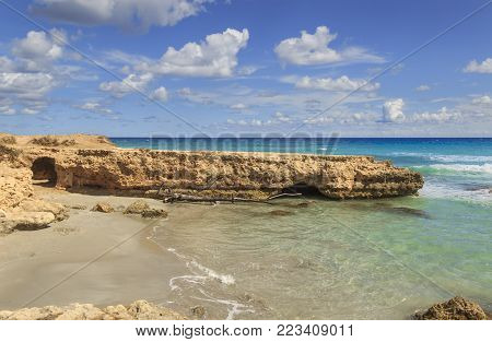 Summmer on solitary beach. Salento coast, Conca Specchiulla ( Apulia,ITALY). From Torre Dell'Orso and Otranto near the high rocky coast, it's characterized by small sandy coves and  dunes covered with dunes covered Mediterranean maquis.