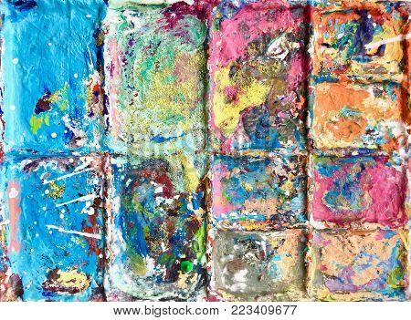 Artist at work painting pallet colour mixing