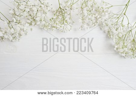 Mock up Composition of white flowers rustic style, for St. Valentine's Day with a place for your text. Flat lay, top view photo mock up.