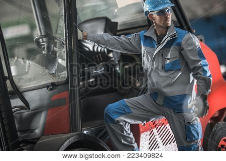 Lift Truck Operator Job. Caucasian Worker and His Forklift. Production Line Warehouse.