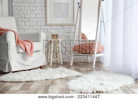 Modern room interior with cozy armchair and fluffy carpets