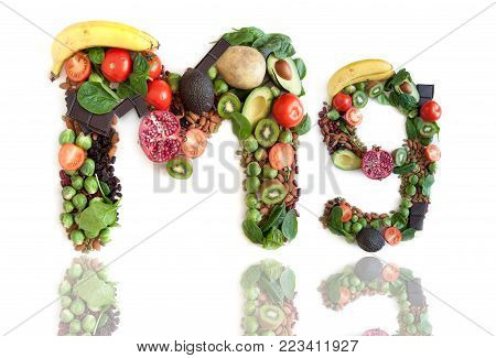 Magnesium symbol Mg made of food over a white background