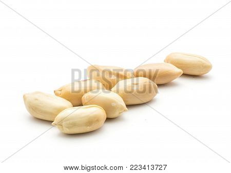 Shelled peanuts (raw and without husk, halves) in row isolated on white background
