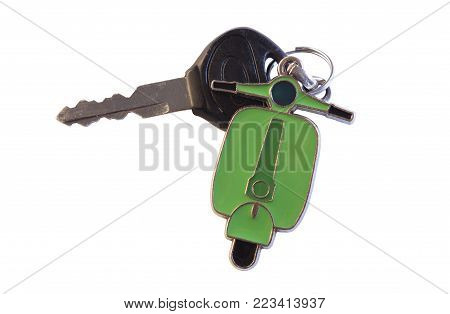 isolated mobile scooter key with a green metal scooter icon hanger attached to the keys with a metal ring