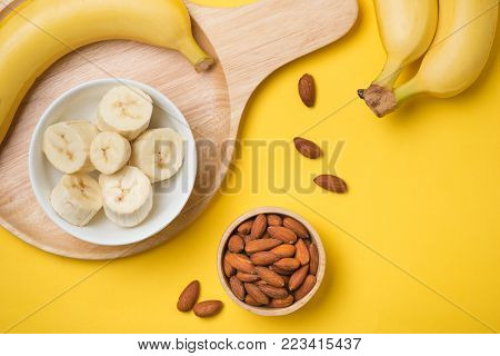 Almond Milk In A Glass With Almond Nuts And Bananas On A Wooden Table. Healthy Food And Drink Concep