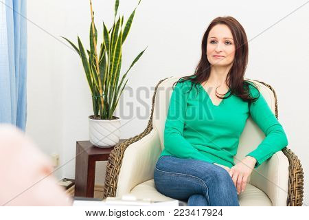 A woman is talking to her psycho therapist.