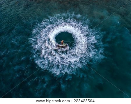 People are playing a jet ski in the sea.Aerial view. Top view.amazing nature background.The color of the water and beautifully bright. Fresh freedom. Adventure day.clear turquoise at tropical beach.
