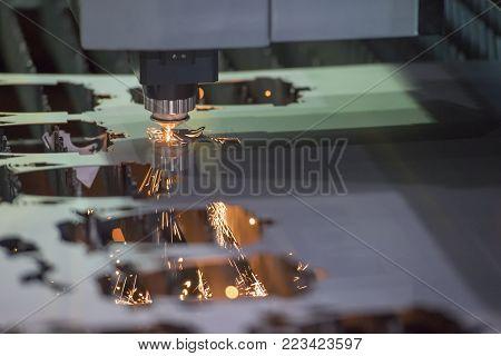 The fiber laser cutting machine controller by CNC program.The sheet metal cutting process by CNC fiber laser cutting.