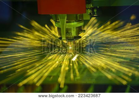 The fiber laser cutting machine controller by CNC program.The sheet metal cutting process by CNC fiber laser cutting.