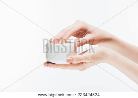 cropped shot of woman opening jar of anti-wrinkle cream isolated on white