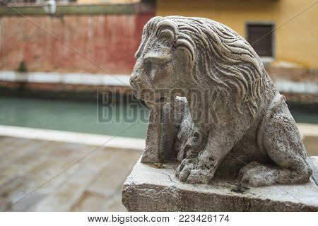 decoration lion sculpture on stone handrails in Venice, Italy