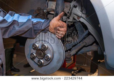 The man finished repairing the disc brake. Disc Brake Repair.
